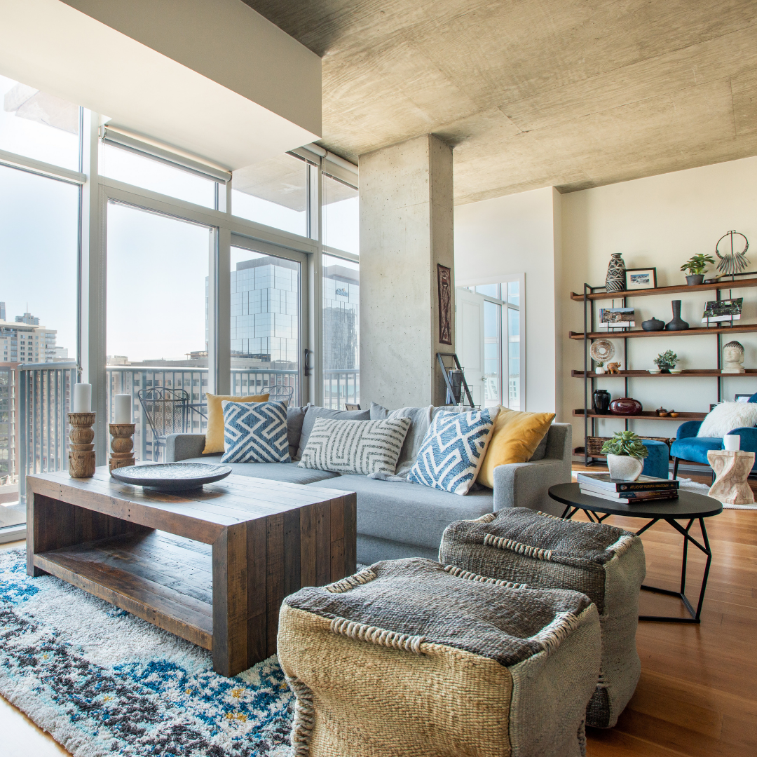 Portfolio Denver Interior Design High rise living room with global décor and modern accents