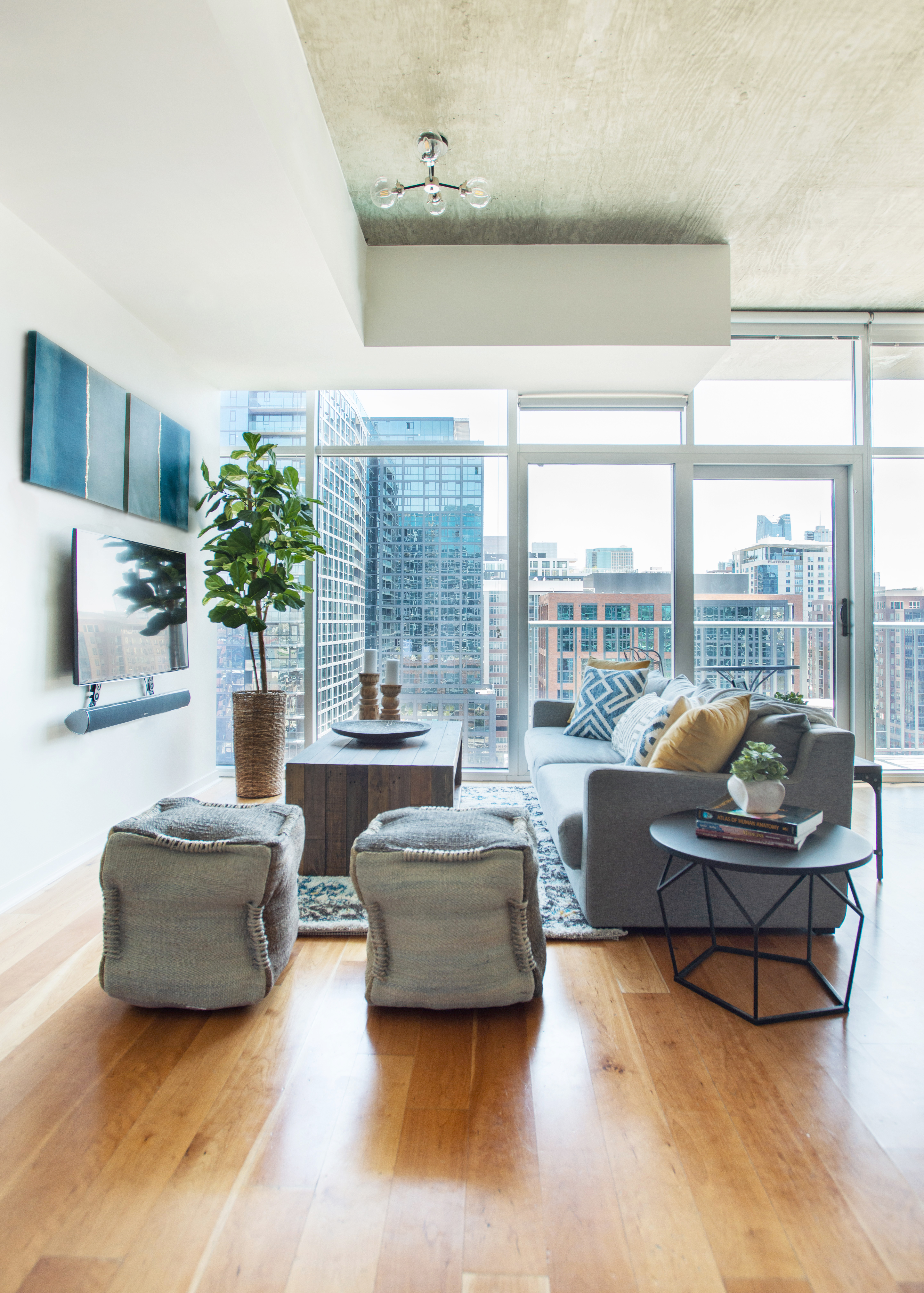 Glass House Condo living room with tv media and downtown view