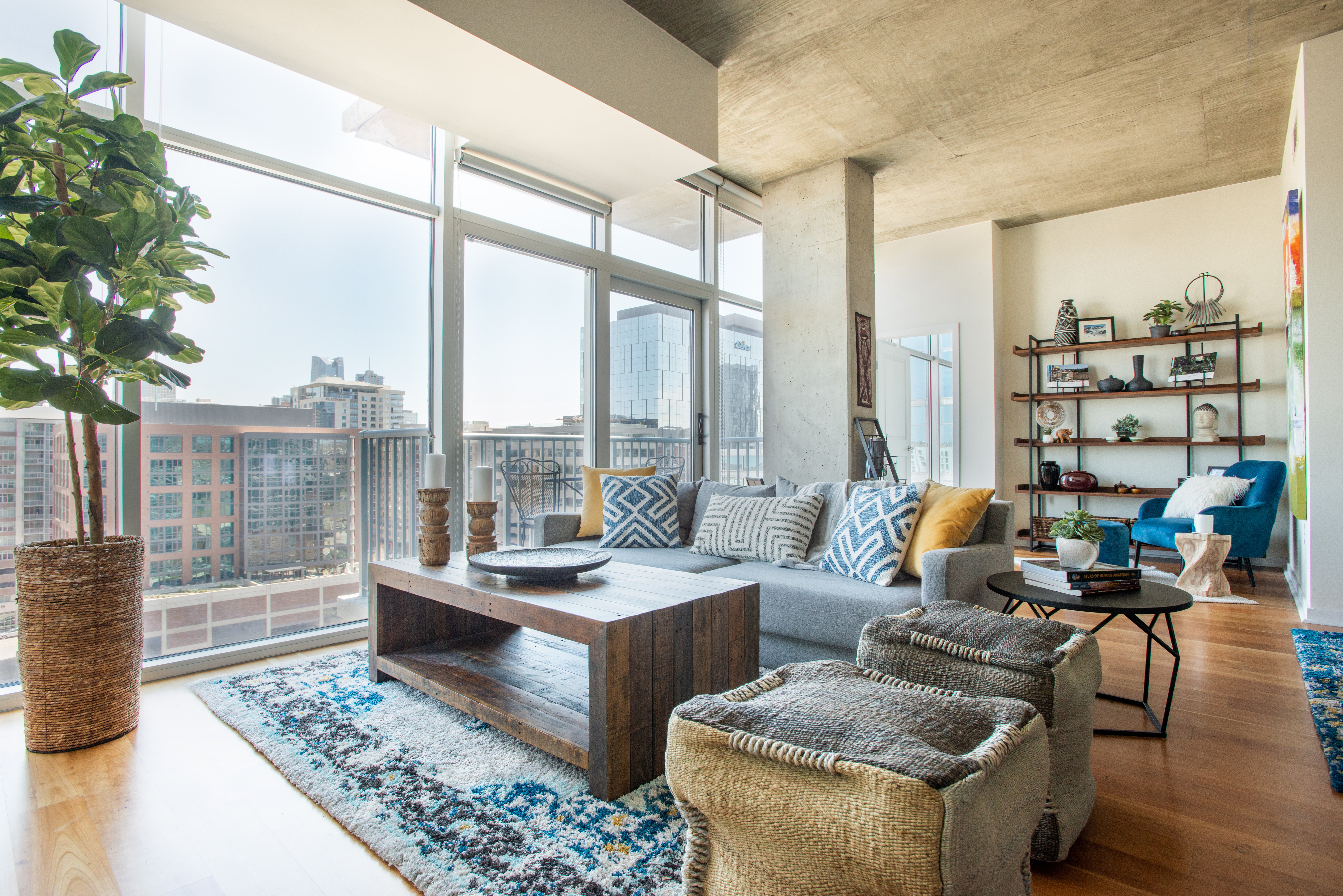 Glass House Condo living room view of downtown Denver with eclectic accents