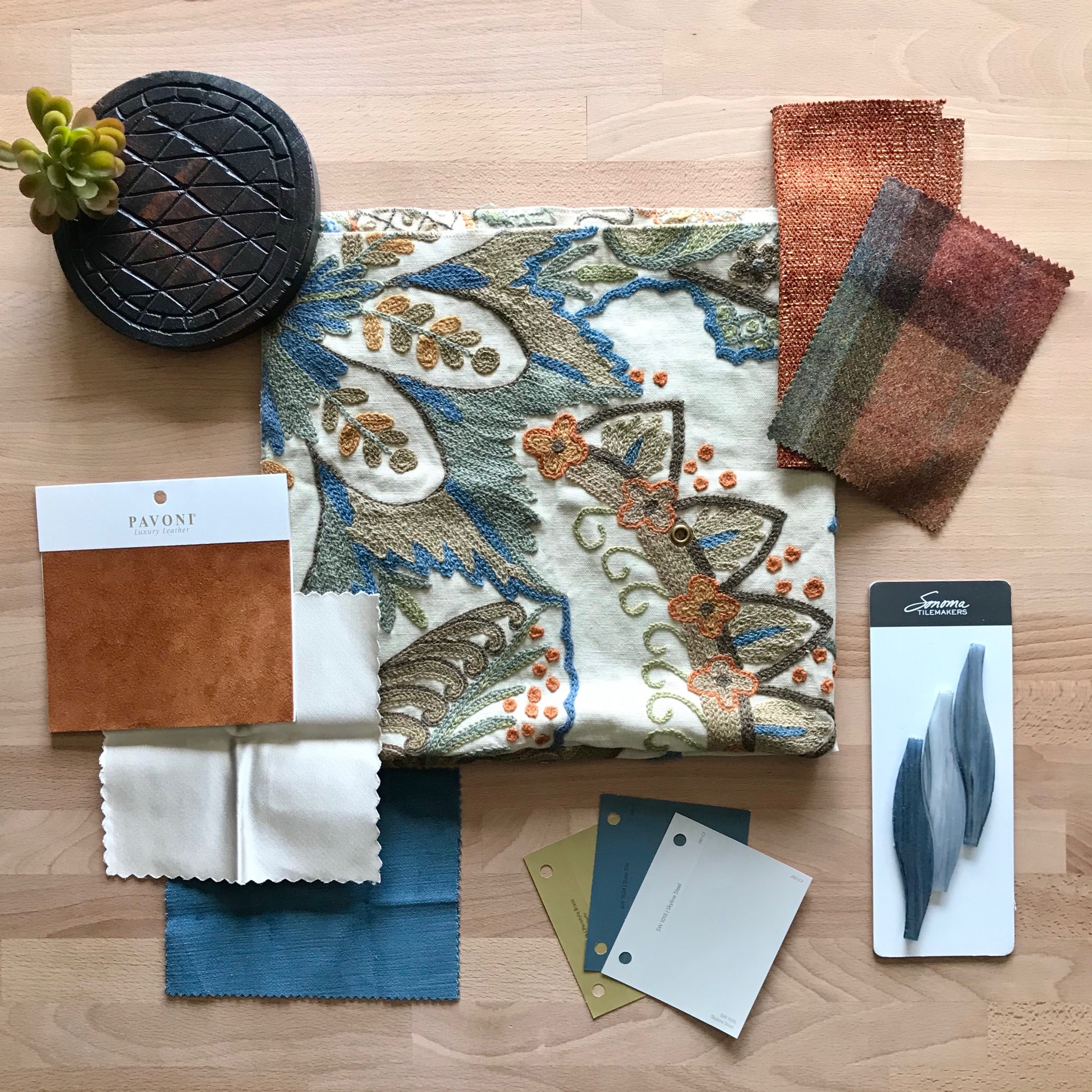 House Meraki design services fabric selections with amber and blue color scheme