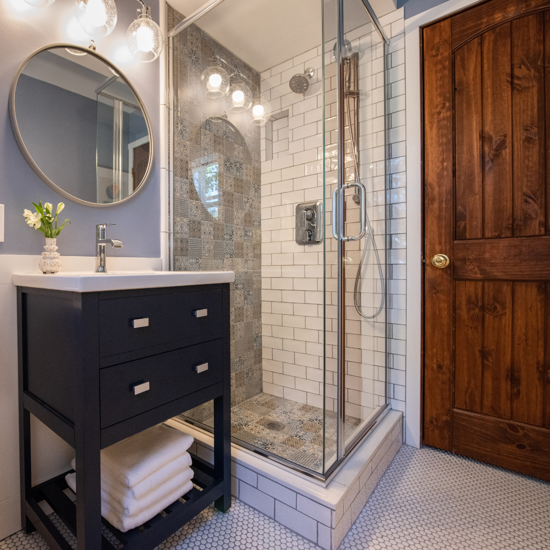 Portfolio remodeled powder room with shower and blue vanity