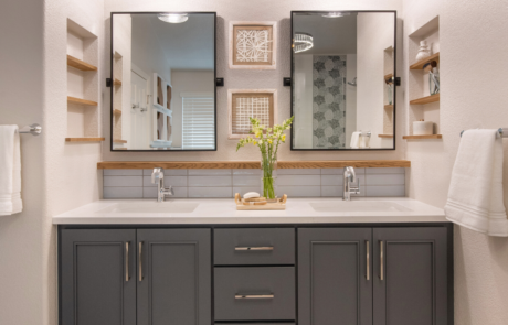 Denver Interior Design bathroom vanity in blue with modern lights and mirrors