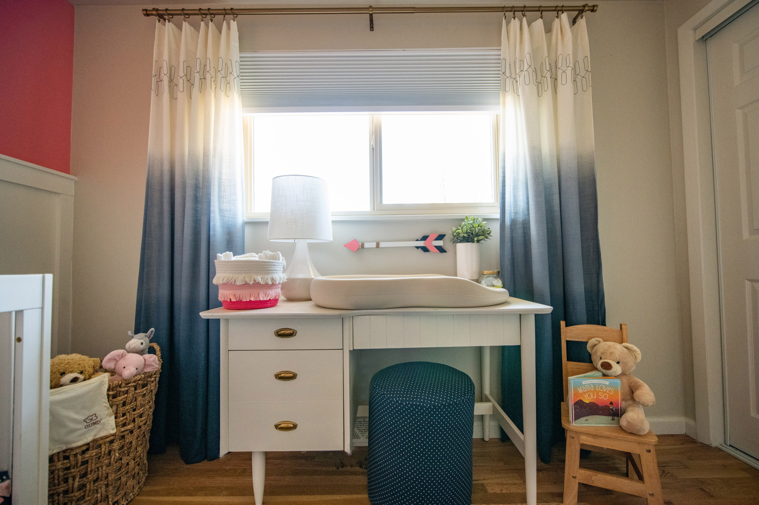 Wolf Nursery changing table wall with blue curtains