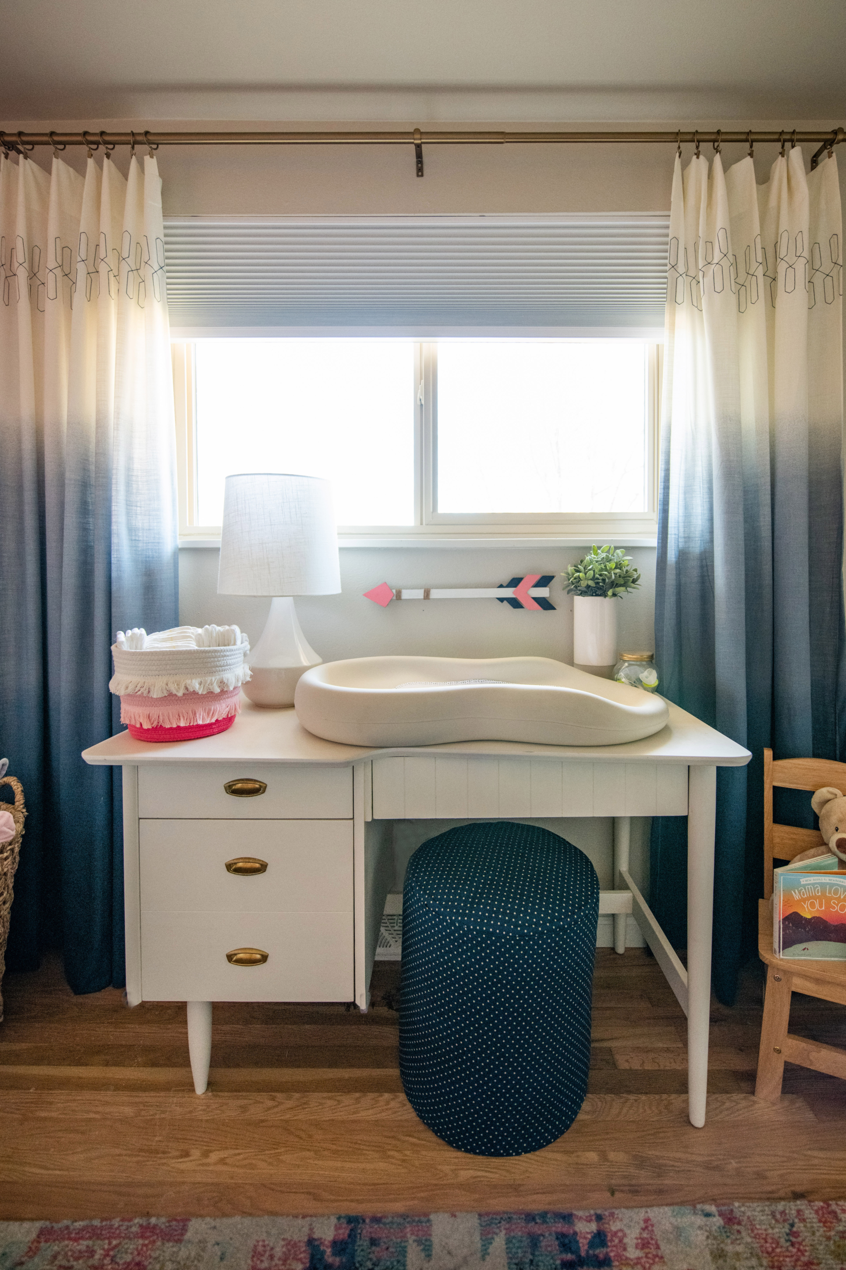 Wolf Nursery changing table with blue curtains and ottoman