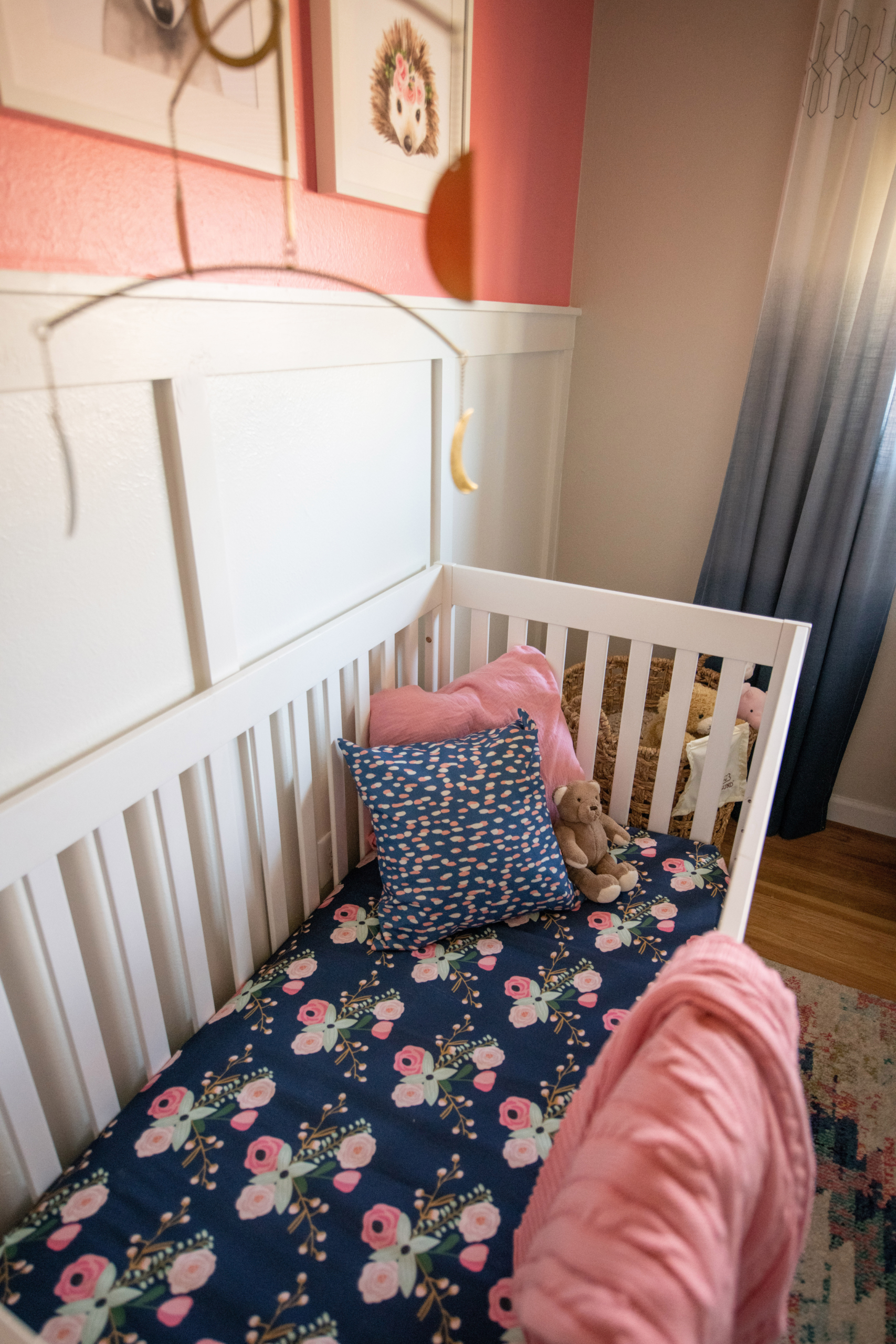 Wolf Nursery interior crib view with floral sheets