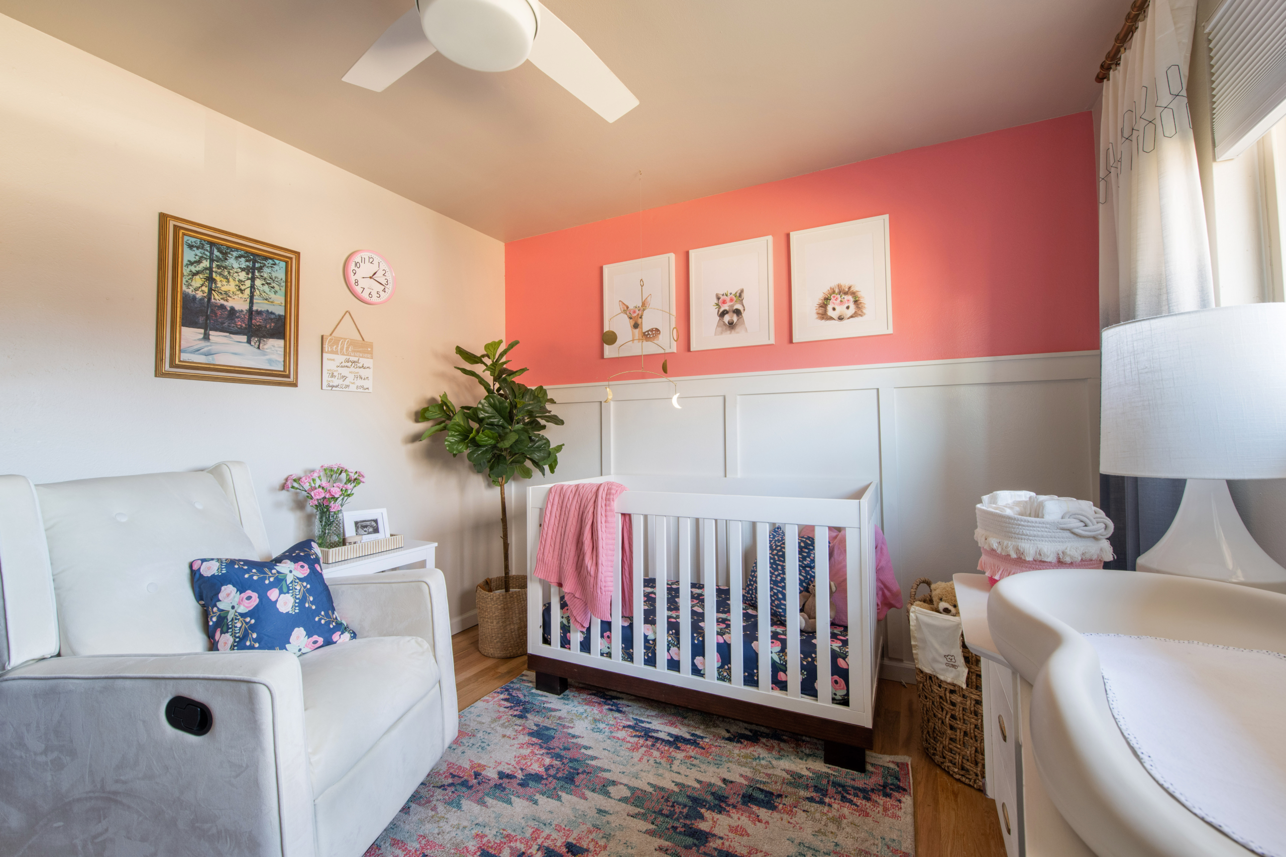 Nursery pink and blue theme with rocking chair and crib