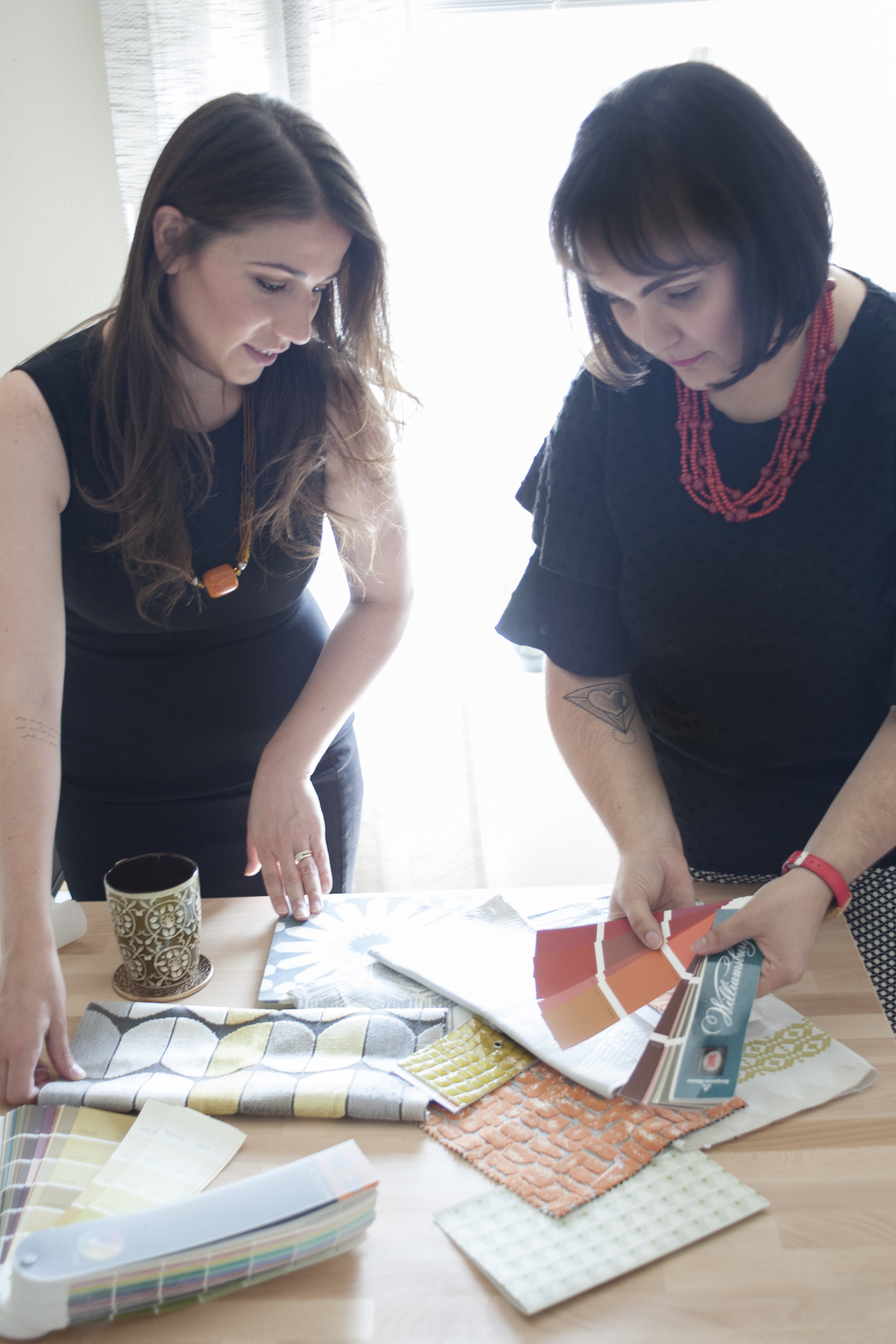 Elizabeth and Adriele working with fabrics and paint to process a project