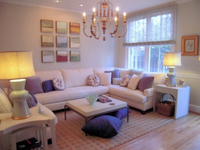 U-shaped sectional wraps a family room perfectly with side tables at each end and a coffee table in the center.