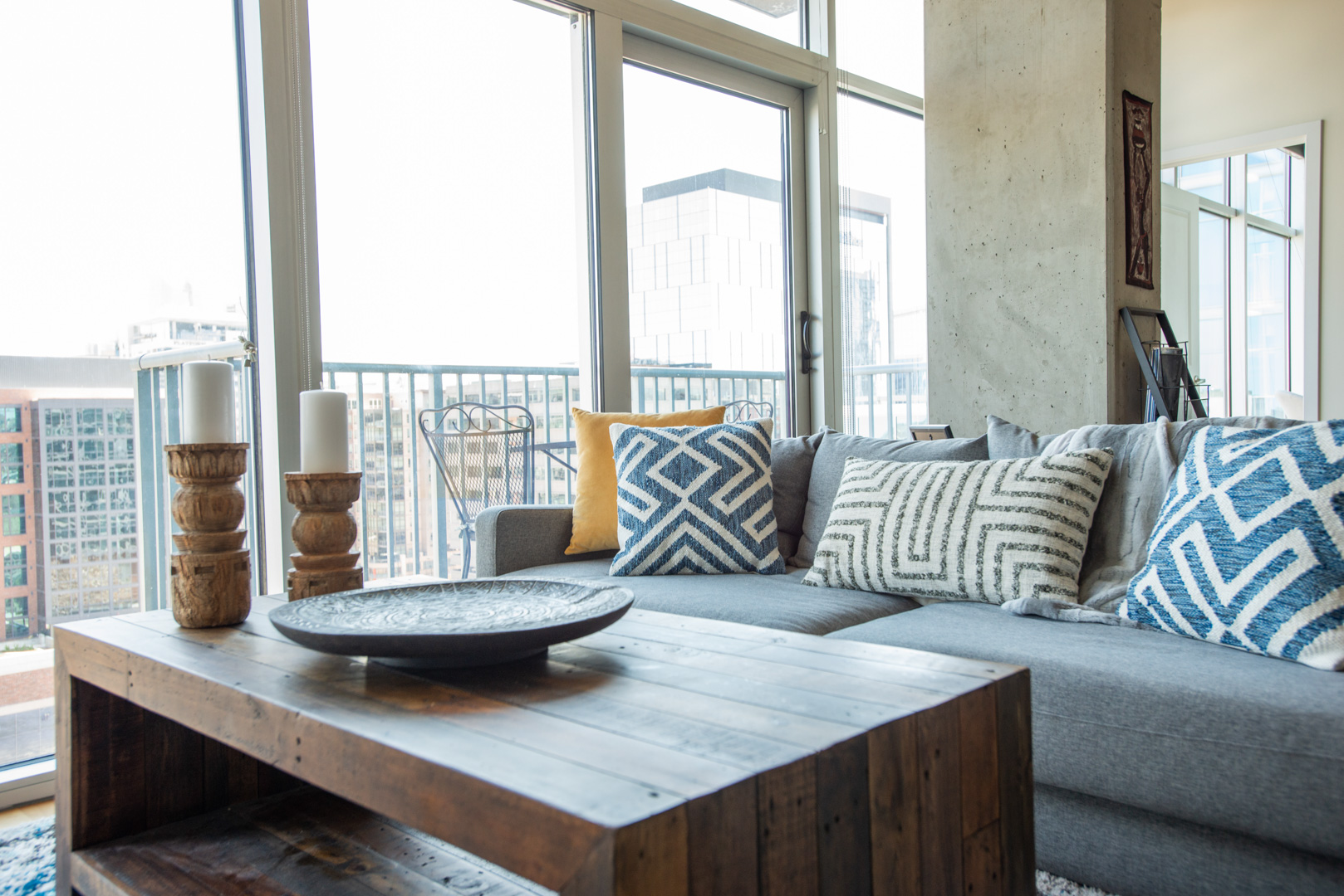 Glass House Condo coffee table and sofa with pillows