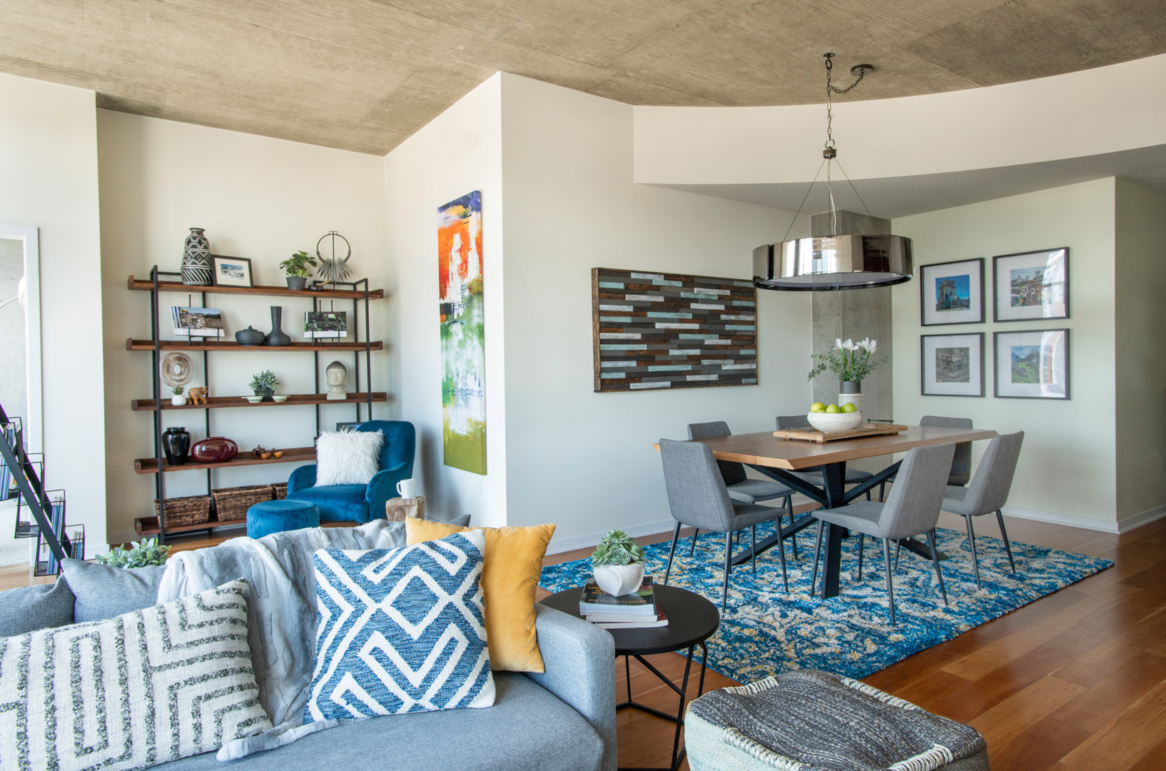 Glass House Loft living room dining room and reading nook with yellow and blue accents and global decor