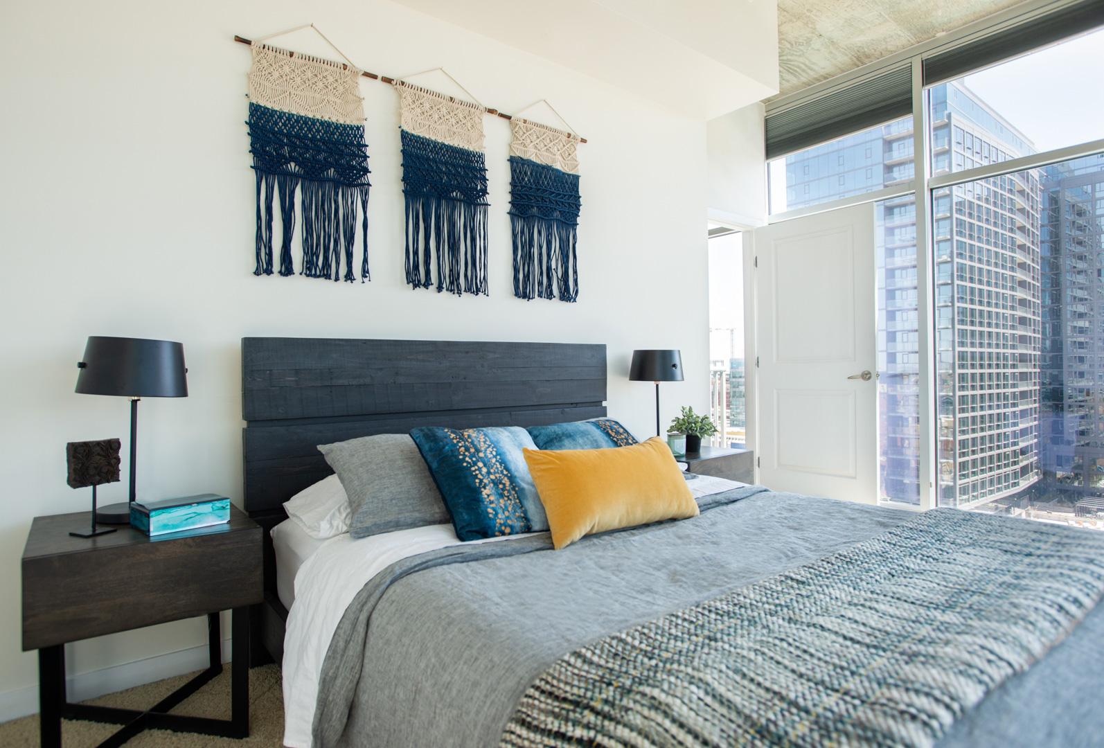 glass house bedroom with macramé art