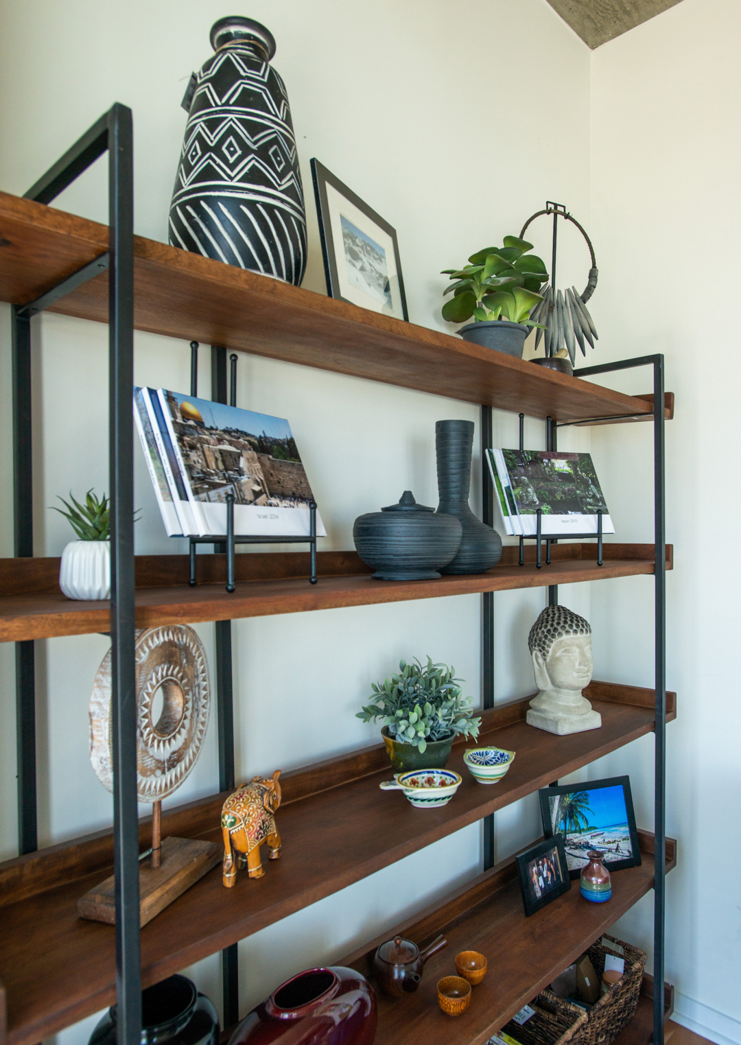 bookcase accessorized with global decor